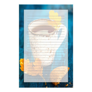 Cup Of Tea And Autumn Leaves On Blue Wooden Stationery