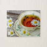 """Cup Of Tea Jigsaw Puzzle<br><div class=""""desc"""">This unique jigsaw puzzle features a image of a cup of tea and some daisies. Please feel free to customize all the changible options,  as you wish.</div>"""