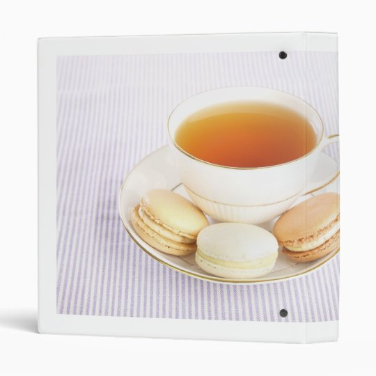 Cup of tea with macaroons and roses binder