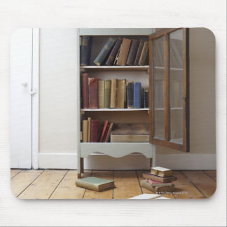Cupboard full of books. mouse pad