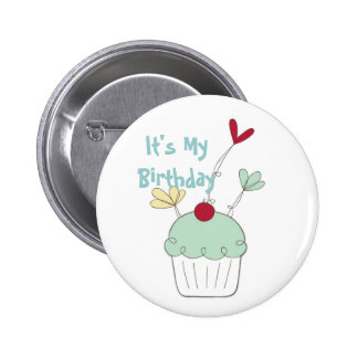 Cupcake birthday badge with cherry and flowers button