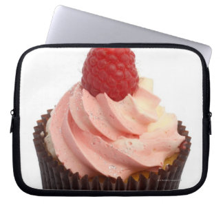 Cupcake topped with raspberry cream and a fresh laptop sleeve
