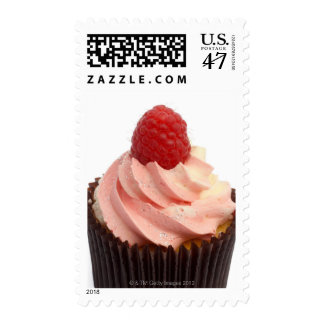 Cupcake topped with raspberry cream and a fresh postage