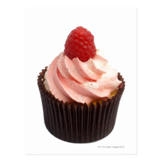 Cupcake topped with raspberry cream and a fresh postcard