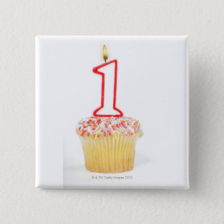 Cupcake with a numbered birthday candle 10 button