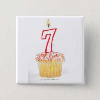 Cupcake with a numbered birthday candle 7 button