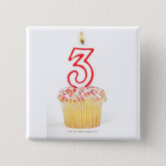 Cupcake with a numbered birthday candle 9 button