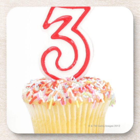 Cupcake with a numbered birthday candle 9 coaster