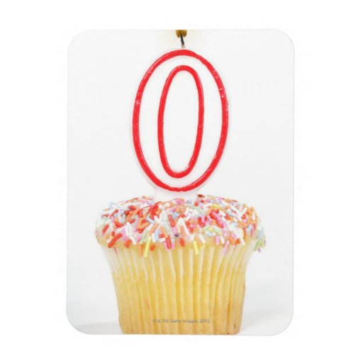Cupcake with a numbered birthday candle rectangular photo magnet