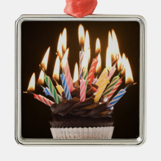 Cupcake with birthday candles christmas ornaments