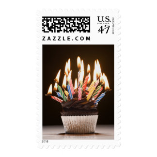 Cupcake with birthday candles postage