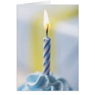 Cupcake with candle, close-up (focus on flame) card
