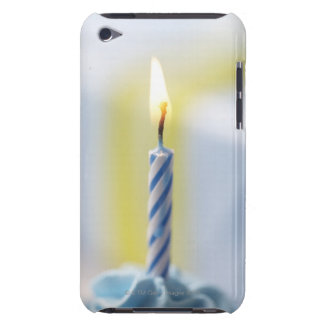 Cupcake with candle, close-up (focus on flame) iPod touch cases