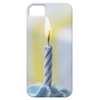 Cupcake with candle, close-up (focus on flame) iPhone 5 covers