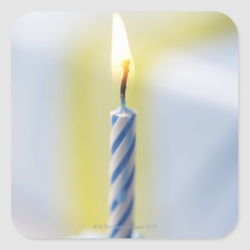 Cupcake with candle, close-up (focus on flame) square sticker