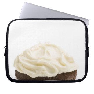 Cupcake with chocolate icing, studio shot 2 laptop sleeve
