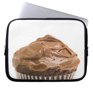 Cupcake with chocolate icing, studio shot laptop sleeve