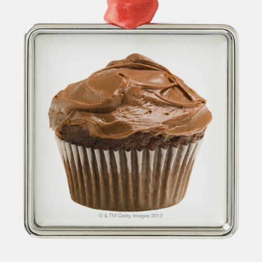 Cupcake with chocolate icing, studio shot metal ornament