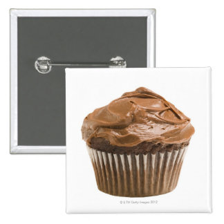 Cupcake with chocolate icing, studio shot pinback button