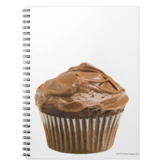 Cupcake with chocolate icing, studio shot spiral notebook