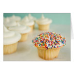 Cupcakes, focus on one in front with greeting cards