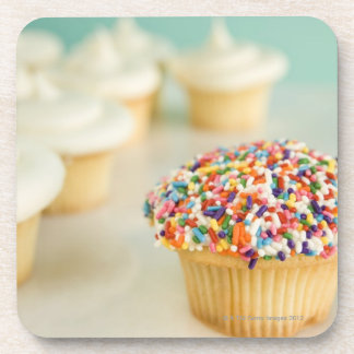 Cupcakes, focus on one in front with drink coaster