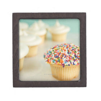 Cupcakes, focus on one in front with gift box