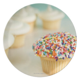 Cupcakes, focus on one in front with melamine plate
