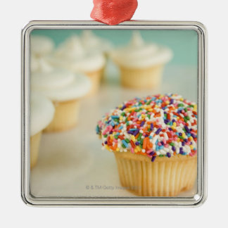 Cupcakes, focus on one in front with metal ornament