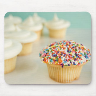 Cupcakes focus on one in front with mouse pad