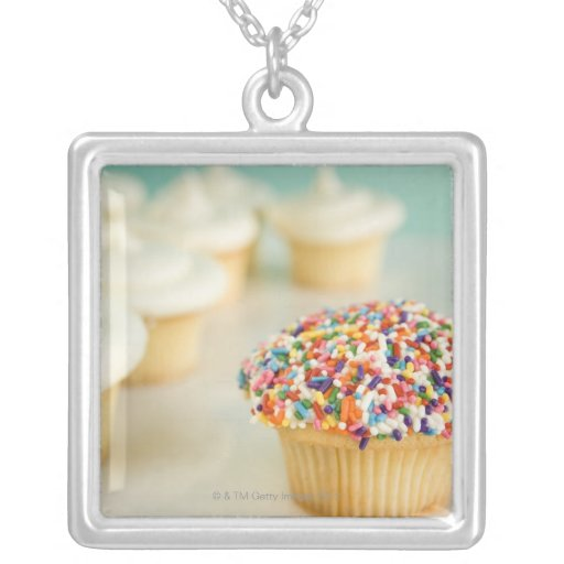 Cupcakes, focus on one in front with square pendant necklace