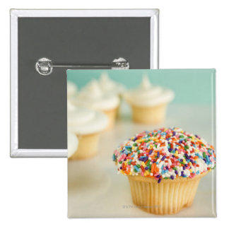 Cupcakes, focus on one in front with pinback button