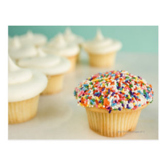 Cupcakes, focus on one in front with postcard