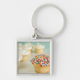 Cupcakes, focus on one in front with Silver-Colored square keychain