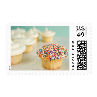 Cupcakes, focus on one in front with stamp