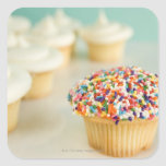 Cupcakes, focus on one in front with square sticker