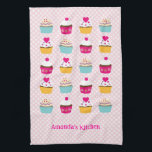 "Cupcakes Kitchen Towels<br><div class=""desc"">Cute and trendy kitchen towel great for a baker or for a cupcake lover. Features a cupcakes pattern in bright colors on a plaid background. Add a name for a custom touch. Makes a great gift.</div>"