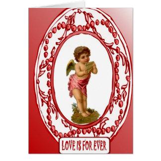 Cupid adaptable de la tarjeta con los panpipes