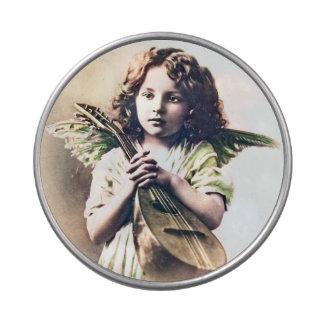 Cupid del ángel del navidad del vintage con lata frascos de dulces