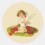 Cupid del vintage en el cojín de lirio pegatina redonda