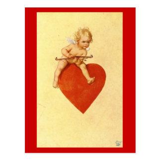 Cupid en un corazón - postal