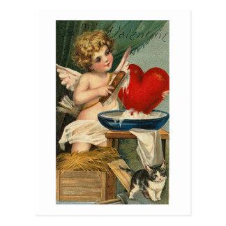 Cupid y gato de limpieza del corazón tarjetas postales