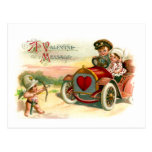 Cupid's Arrow Points at Couple in Car Postcard