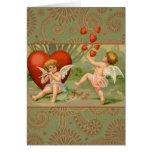Cupids del vintage el día de San Valentín con los  Tarjeton