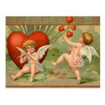 Cupids del vintage el día de San Valentín con los  Tarjeta Postal
