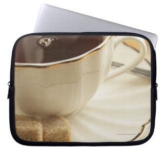 Cups of coffee and sugar. laptop computer sleeves