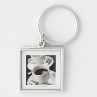 Cups of coffee with saucer keychain