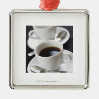 Cups of coffee with saucer christmas ornaments