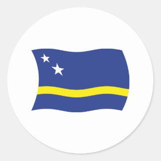 Curaçao señala al pegatina por medio de una