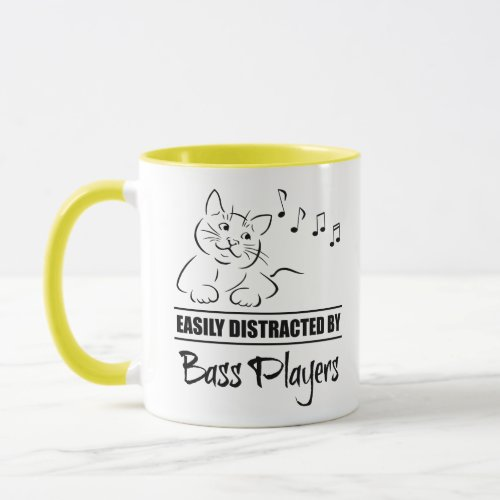 Curious Cartoon Cat Easily Distracted by Bass Players Music Notes Mug